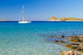 White yacht on the idyllic beach lagoon of Crete Royalty Free Stock Images
