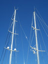 White Yacht Masts Against Clear Blue Sky Royalty Free Stock Photo