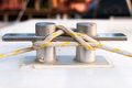 White and yellow stripe rope on the belay at marina Royalty Free Stock Image