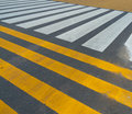 White and yellow stripes signaling a crossing for pedestrians Stock Image