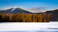 Whiteface mountain peak viewed from the frozen paradox bay in lake placid upstate new york Royalty Free Stock Photo