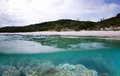 Whitehaven beach a split under and over photograph of and living coral reef Royalty Free Stock Photo