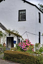 Whitewashed English cottage Royalty Free Stock Photo