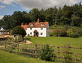 Whitewashed English Rural Farmhouse Stock Photo