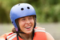 Whitewater rafter portrait adult woman wearing typical water sport outfit Stock Photo