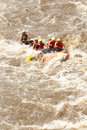 Whitewater river rafting boat adventure group of mixed tourist men and women with guided by professional pilot on in ecuador Stock Photo