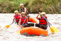 Whitewater river rafting boat adventure group of mixed tourist men and women with guided by professional pilot on in ecuador Stock Photos