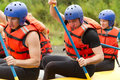 Whitewater river rafting training group of young athletes for Royalty Free Stock Photo