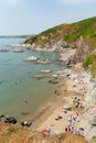 Whitsand bay beach cornwall coast england uk people on near to plymouth during summer heatwave of Stock Photo