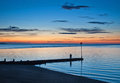 Whitstabe sunset and jetty Royalty Free Stock Photo