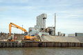 Whitstable cement works the at harbor with a loading unloading crane Royalty Free Stock Photo