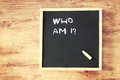 Who am i concept written over chalkboard pic Stock Photography