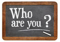 Who are you question on a vintage blackboard isolated on white Stock Photos