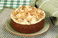 Whole carrot cake wit buttercream icing and chopped walnuts Stock Photos