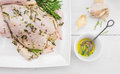 Whole chicken preparation for grill roasting with oil rosemary and garlic on white wooden table Stock Images