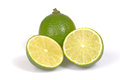 Whole and cut in half citrus lime on white background Royalty Free Stock Photos