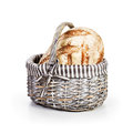Whole grain bread basket with fresh on white background Stock Photos