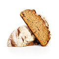 Whole grain bread fresh cut in half on white background Royalty Free Stock Photo