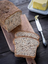 Whole grain bread fresh homemade wheat with linum and cannabis served with butter Stock Photography