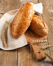 Whole grain bread grain bread on wooden background Stock Photos