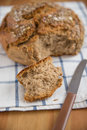 Whole Grain Bread with a knife Royalty Free Stock Photo