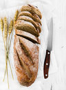 Whole grain bread on wooden background Royalty Free Stock Photo