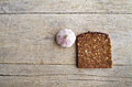 Whole grain brown bread and pungent garlic. Royalty Free Stock Photo