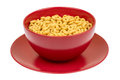Whole grain cheerios cereal in the red bowl. Royalty Free Stock Photo