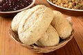 Whole grain dinner rolls a basket of multi with stuffing and cranberry sauce Royalty Free Stock Photo