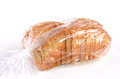 Whole grain sliced bread in plastic bag on white background Stock Photos
