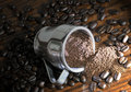 Whole and ground coffee beans Stock Photos
