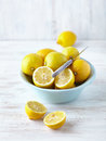 Whole and halved lemons in a bowl Stock Images