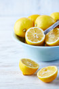 Whole and halved lemons in a bowl Royalty Free Stock Images