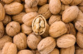 Whole and hulled walnuts Royalty Free Stock Images