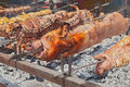 Whole pigs roast spit roasted a cooked over hot coals gastronomic traditions of sardinia italy roasting pig porceddu on the rack Royalty Free Stock Images