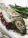 Whole River Trout with Jamon and Herb Butter Royalty Free Stock Photos