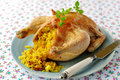 Whole roast chicken stuffed with curried rice and sultanas selective focus Royalty Free Stock Photo