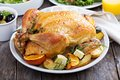 Whole roasted chicken on dinner table Royalty Free Stock Photo