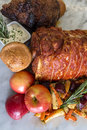 Whole roasted joints roast beef and pork with vegetables yorkshire pudding and herb dip Royalty Free Stock Images