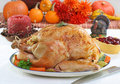 Whole roasted turkey in Thanksgiving setting. Royalty Free Stock Image