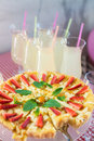 Whole round apple pie decorated with strawberry on a glass stand Royalty Free Stock Photo