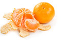 Whole  tangerine and peeled mandarin Stock Image