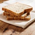 Whole wheat bread on kitchen table still life photography Stock Image