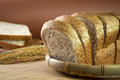Whole wheat bread loaf sliced on bamboo basket Royalty Free Stock Photos