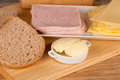 Whole wheat bread slices to prepare a ham and cheese sandwich Royalty Free Stock Photo