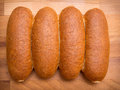 Whole wheat buns hot dog on cutting board Royalty Free Stock Photo
