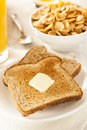 Whole wheat buttered toast at breakfast time Royalty Free Stock Photos