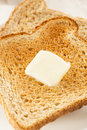 Whole wheat buttered toast at breakfast time Stock Photography