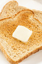 Whole wheat buttered toast at breakfast time Royalty Free Stock Images