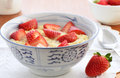 Whole wheat cereal with strawberries for a healthy breakfast Stock Photos